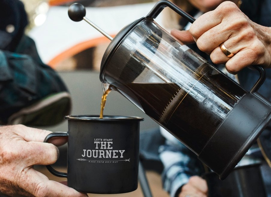 man pouring coffee from french press