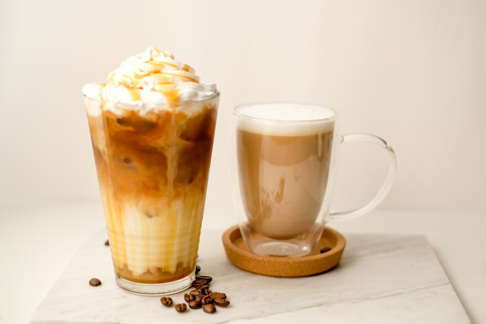 ice coffee in the glass topped whipping cream with coffee beans